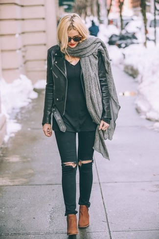 How to wear: black leather biker jacket, black v-neck sweater, black ripped skinny jeans, tobacco leather ankle boots