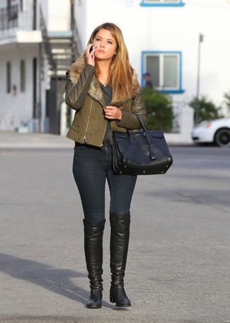 This pairing of an olive biker jacket and black skinny jeans is a safe bet for an effortlessly cool look. Choose a pair of Louise et Cie women's Andora Over The Knee Boot to va-va-voom your outfit. When it's one of those dull autumn days, sometimes only a neat getup like this one can get you out the door in the morning.