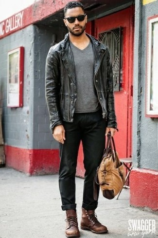 If you're facing a sartorial situation where comfort is prized, opt for a black leather biker jacket and black casual trousers. Polish off the ensemble with brown leather casual boots. A look like this makes it easy to embrace weird transitional season.