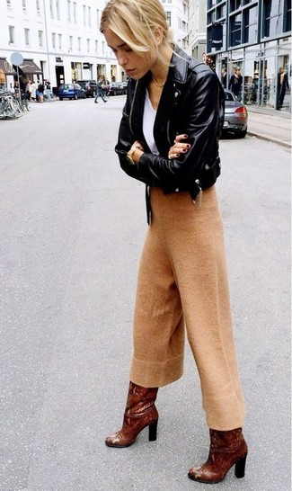 How to wear: black leather biker jacket, white v-neck t-shirt, tan wool culottes, brown leather knee high boots