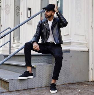 Men's Looks & Outfits: What To Wear In 2020: Look seriously stylish yet comfortable by wearing a black leather biker jacket and black jeans. Our favorite of an infinite number of ways to finish this outfit is black canvas low top sneakers.
