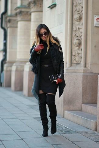 How to wear: black leather biker jacket, black fur vest, black sweater dress, black suede over the knee boots