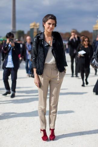 How to wear: black leather biker jacket, black fur vest, white silk tank, beige tapered pants