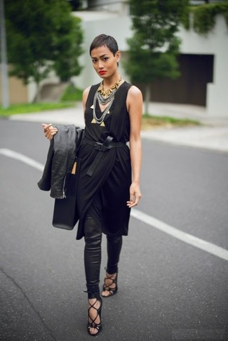How to wear: black leather biker jacket, black wrap dress, black leggings, black suede gladiator sandals