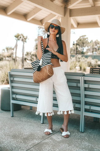 Bikini Top Outfits: White linen culottes and a bikini top are a cool combination to carry you throughout the day and into the night. White canvas flat sandals are a stylish accompaniment to this outfit.