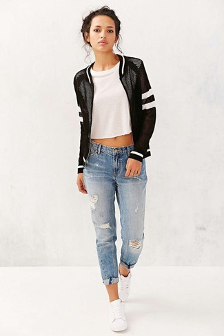 How to Wear a Black and White Bomber Jacket For Women: This combination of a black and white bomber jacket and blue ripped boyfriend jeans provides comfort and efficiency and helps you keep it low-key yet contemporary. Up the fashion factor of your ensemble by rounding off with a pair of white low top sneakers.
