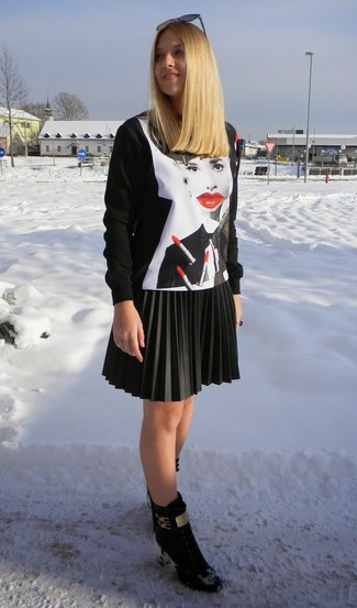 Team a black and white print crew-neck pullover with a black pleated leather mini skirt for an effortless kind of elegance. Take a classic approach with the footwear and make black suede lace-up ankle boots your footwear choice.