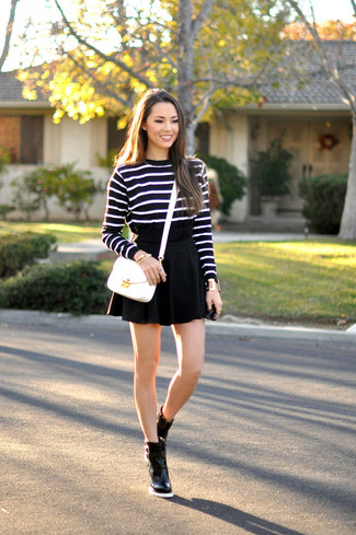 How to wear: black and white horizontal striped crew-neck sweater, black skater skirt, black leather ankle boots, white leather crossbody bag