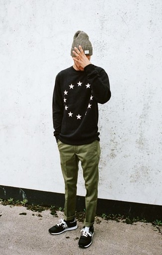 How to wear: black and white star print crew-neck sweater, olive chinos, black athletic shoes, olive beanie