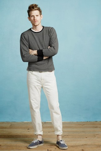 How to wear: black and white horizontal striped crew-neck sweater, white crew-neck t-shirt, white chinos, navy canvas low top sneakers