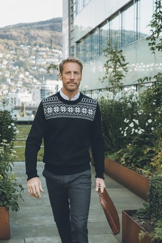 Fashion for Men Over 40: What To Wear: Team a black and white fair isle crew-neck sweater with charcoal dress pants to ooze elegance and refinement.