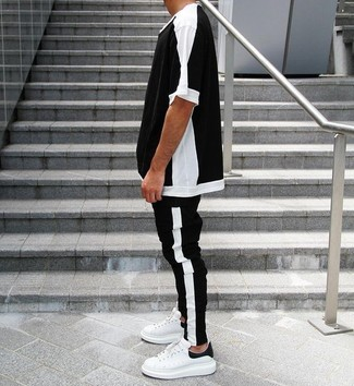 How to Wear a Black and White Crew-neck T-shirt For Men: For the style that looks as cool as it can get, make a black and white crew-neck t-shirt and black and white sweatpants your outfit choice. To give your overall ensemble a more refined spin, why not complement this ensemble with white and black leather low top sneakers?