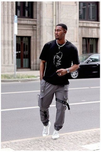 500+ Summer Outfits For Men: Why not consider wearing a black and white print crew-neck t-shirt and grey cargo pants? These pieces are totally practical and will look good matched together. Look at how well this ensemble pairs with grey print canvas high top sneakers. If you're on the hunt for a summer-friendly ensemble, this here is your inspiration.
