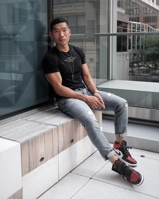 How to Wear a Black and White Print Crew-neck T-shirt For Men: A black and white print crew-neck t-shirt and grey ripped jeans worn together are a match made in heaven. We're totally digging how cohesive this outfit looks when complemented by red and black leather high top sneakers.