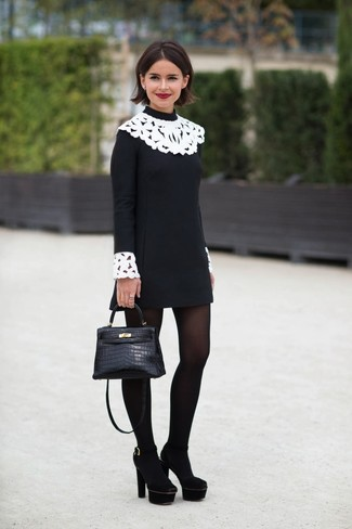 Wear black and white lace dress for a casual get-up. You could perhaps get a little creative when it comes to footwear and lift up your getup with black suede pumps. On not-so-bone-chilling days, you can wear this transitional look and look absolutely awesome.