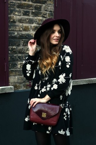 How to wear: black and white floral swing dress, burgundy leather crossbody bag, burgundy wool hat