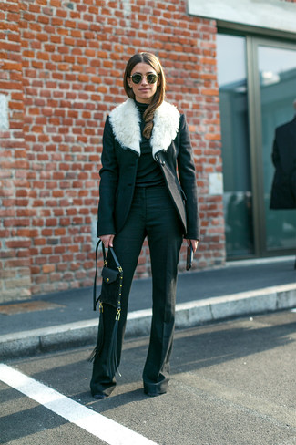 Make a black and white fur collar coat and black flare pants your outfit choice for a stylish office ensemble. You can be certain this combo is ideal for fluctuating autumn weather.