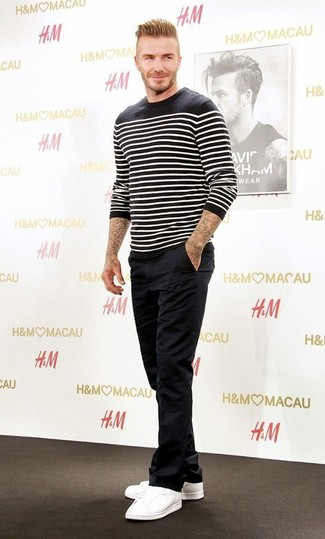David Beckham wearing Black and White Horizontal Striped Crew-neck Sweater, Black Chinos, White Low Top Sneakers