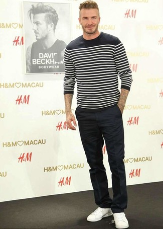 How to wear: black and white horizontal striped crew-neck sweater, black dress pants, white leather low top sneakers