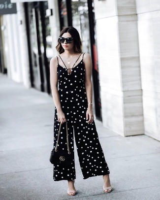 How to wear: black and white polka dot jumpsuit, beige leather heeled sandals, black leather crossbody bag, black sunglasses