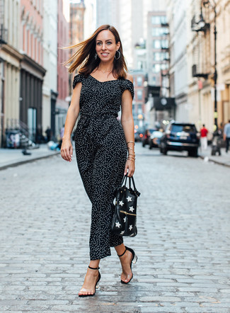 How to Wear Clear Rubber Heeled Sandals: Go for a black and white polka dot jumpsuit, if you feel like relaxed dressing but also want to look chic. Clear rubber heeled sandals will infuse a dash of sophistication into an otherwise mostly dressed-down getup.