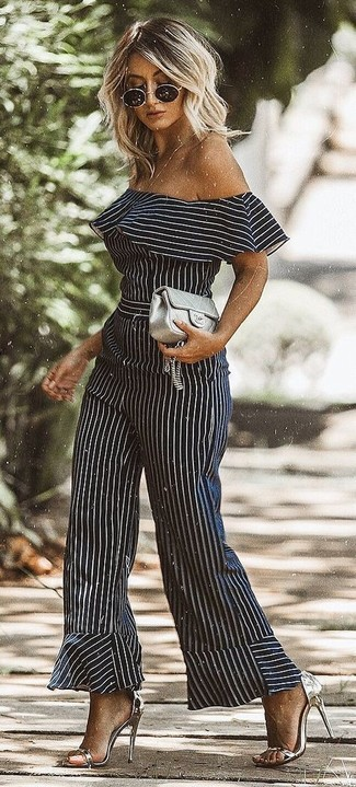 How to wear: black and white vertical striped jumpsuit, silver leather heeled sandals, grey quilted leather clutch, black sunglasses