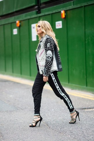 How to wear: black and white leather biker jacket, black and white tapered pants, black studded leather heeled sandals