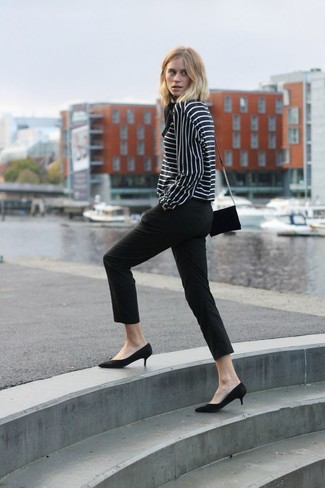 A black and white striped long sleeve blouse and capri pants are both versatile essentials that will give your outfits a subtle modification. A pair of black suede pumps adds some real flair to this look. Keep the autumn anxiety at bay in a neat outfit like this one.