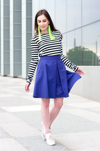 How to wear: black and white horizontal striped long sleeve t-shirt, blue full skirt, white low top sneakers, green earrings