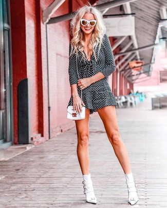 How to wear: black and white polka dot playsuit, white leather ankle boots, white leather crossbody bag, white sunglasses