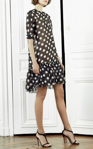 Consider wearing a black and white polka dot shift dress to ooze class and sophistication. Black and tan leather heeled sandals are a great choice to complete the look.
