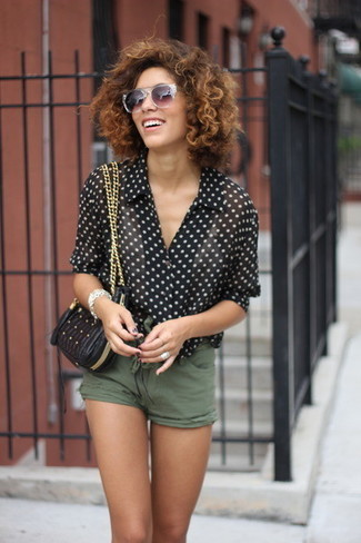 How to wear: black and white polka dot short sleeve blouse, olive shorts, black quilted leather crossbody bag