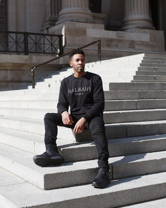 Black and White Print Sweatshirt Outfits For Men: If the setting allows a casual look, marry a black and white print sweatshirt with black jeans. A pair of black athletic shoes adds edginess to this outfit.