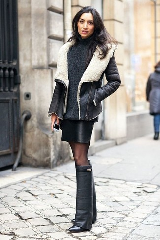 This combination of a black and white shearling jacket and a black leather mini skirt is perfect for off-duty occasions. Finish off your look with black leather knee high boots.