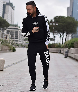 How to wear: black and white track suit, black athletic shoes