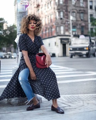 How to wear: black and white polka dot wrap dress, blue ripped jeans, black leather loafers, burgundy leather bucket bag