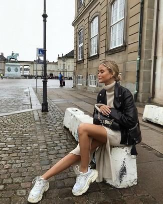 How to wear: black leather biker jacket, beige sweater dress, white athletic shoes, black leather satchel bag