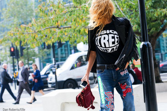 How to wear: black fringe leather biker jacket, black and white print crew-neck t-shirt, blue embroidered jeans, burgundy suede clutch