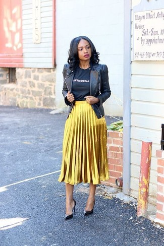 How to wear: black leather biker jacket, black and white print crew-neck t-shirt, gold pleated midi skirt, black leather pumps