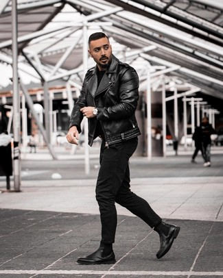 How to wear: black leather biker jacket, black crew-neck sweater, black jeans, black leather chelsea boots