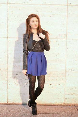 A black lace cropped top and a blue skater skirt are a perfect combo to be utilised at the weekend. Throw in a pair of black leather ankle boots to take things up a notch. We're loving that this combo is great when real summer weather settles in.