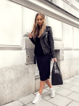 Rock a black leather biker jacket with a black leather tote bag for a comfy-casual look. Dress down your getup with silver running sneakers. We promise this getup is the answer to all of your transitional wear problems.