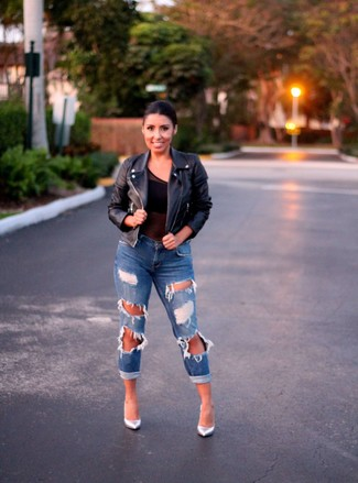 Blue Ripped Boyfriend Jeans Outfits: A black leather biker jacket and blue ripped boyfriend jeans are the kind of a never-failing casual combo that you so terribly need when you have no time to spare. For something more on the elegant side to complete your look, complete this getup with silver leather pumps.