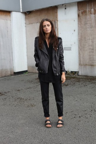 How to wear: black leather biker jacket, black tunic, black chinos, black leather flat sandals