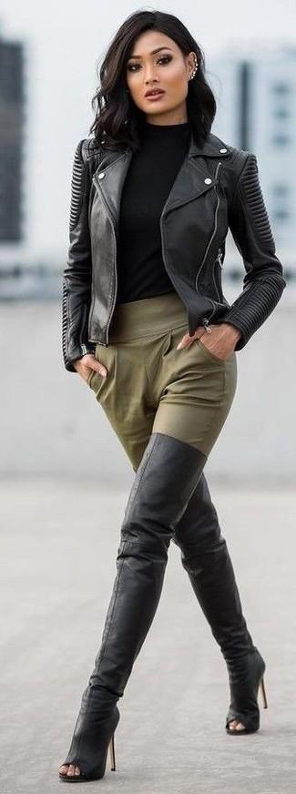 How to wear: black leather biker jacket, black turtleneck, olive tapered pants, black leather over the knee boots