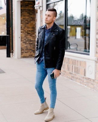 Beige Suede Chelsea Boots Outfits For Men: This combo of a black quilted leather biker jacket and light blue skinny jeans is proof that a safe casual getup can still look really dapper. Unimpressed with this ensemble? Enter a pair of beige suede chelsea boots to jazz things up.