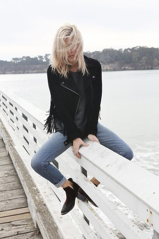 How to wear: black fringe suede biker jacket, charcoal crew-neck t-shirt, blue skinny jeans, black suede ankle boots