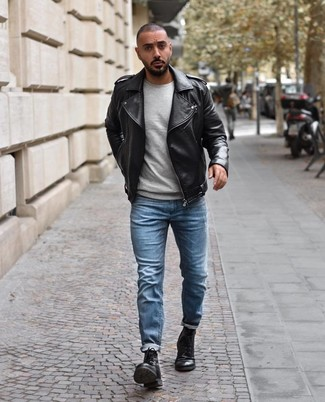 How to wear: black leather biker jacket, grey crew-neck sweater, light blue jeans, black leather casual boots