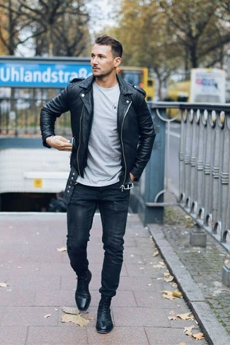 How to wear: black leather biker jacket, grey crew-neck t-shirt, black skinny jeans, black leather dress boots