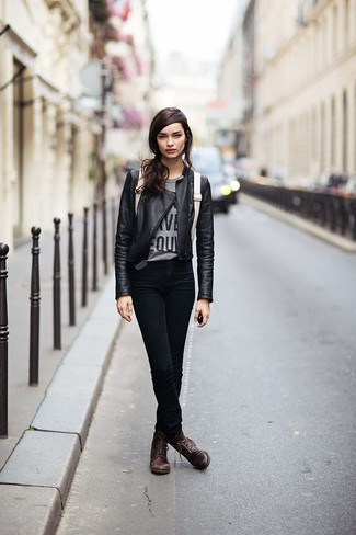 This combo of a black leather biker jacket and black slim jeans is a safe bet for an effortlessly cool look. A pair of dark brown leather lace-up flat boots will be a stylish addition to your outfit.